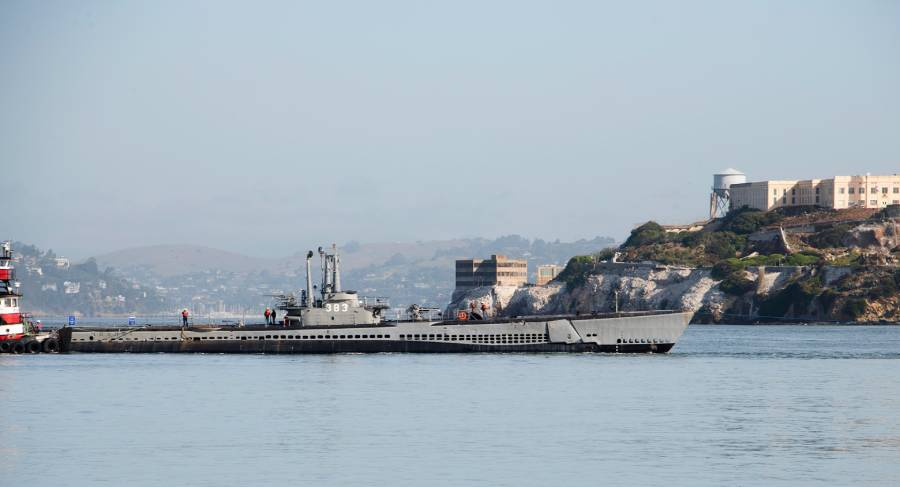 Pampanito under tow past Alcatraz on the way to drydock.